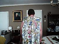 Жирный мужик примеряет вещи жены перед камерой - кроссдресс